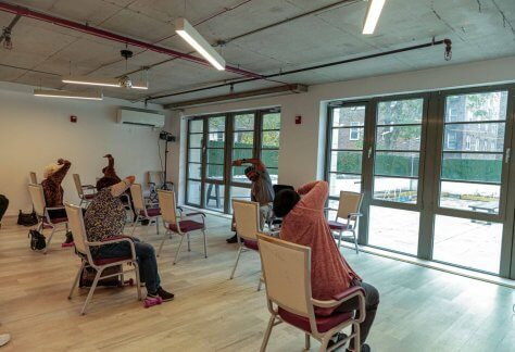 Oasis members in Brooklyn practicing Yoga with instructor