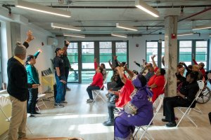 Member at Oasis Adult Day Center practicing tai Chi in Class